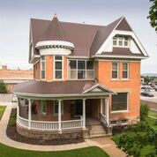 Classic Victorian House with Cedar Shake Metal Roof
