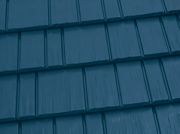 Blue metal shingle roof to illustrate What Kind Of Roof Damage Is Covered By Insurance?