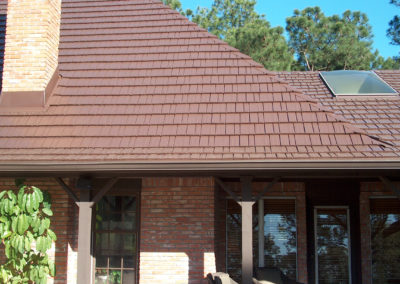 Close up of Terra Red Cedar Shake Metal Roof on brick house in Portland, OR