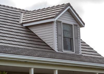 Close up of Gray Cedar Shake Metal Roof over Bay Window