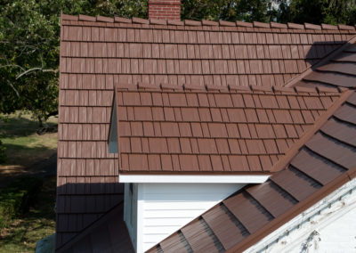 Close up of Multi Roof Pitch Metal Roof - Cedar Shake