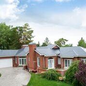Vermont Slate Cedar Shake Metal Roof on a Brick Home in Multnomah County