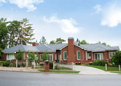 Vermont Slate Cedar Shake Metal Roof on a Brick Home, view from street