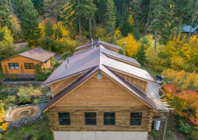 Full Pitch View of Slate Roof on wood siding house and cabin