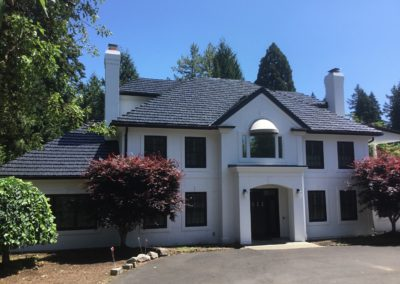 two story white house metal slate roof