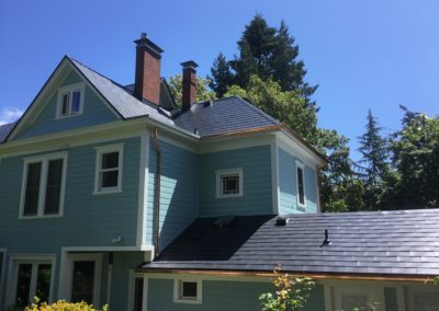 metal shake roof blue house with copper gutters