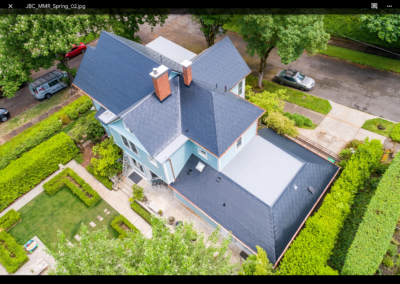 metal roof aerial view on blue house