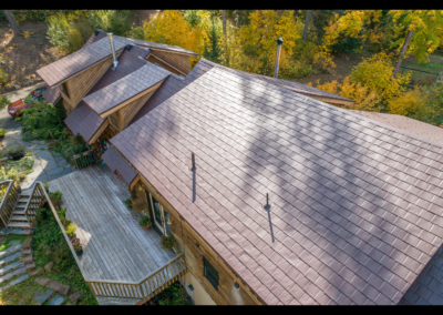 Aerial view metal slate shingles on wood finished house