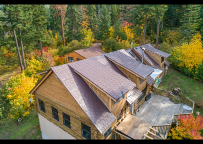 tan metal roof aerial view on wood finished house