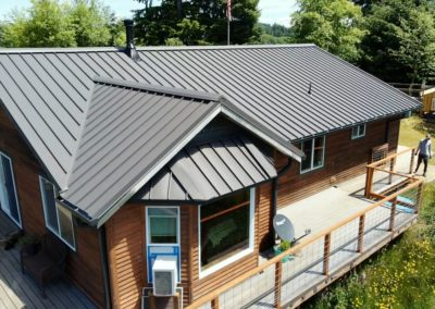 Standing seam metal roof on a county home